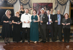 Among 2014 Business of the Year Award Winners is, third from right, ZRFM's Jonathan Feinstein. Photo courtesy Claudia Halip.